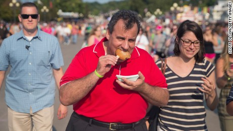 Republican presidential candidate New Jersey Governor Chris Christie samples fried peanut butter and jelly during a visit to the Iowa State Fair on August 22, 2015 in Des Moines, Iowa.