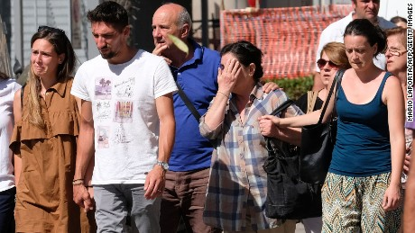 People arrive Wednesday at a Bari, Italy, hospital to identify bodies.