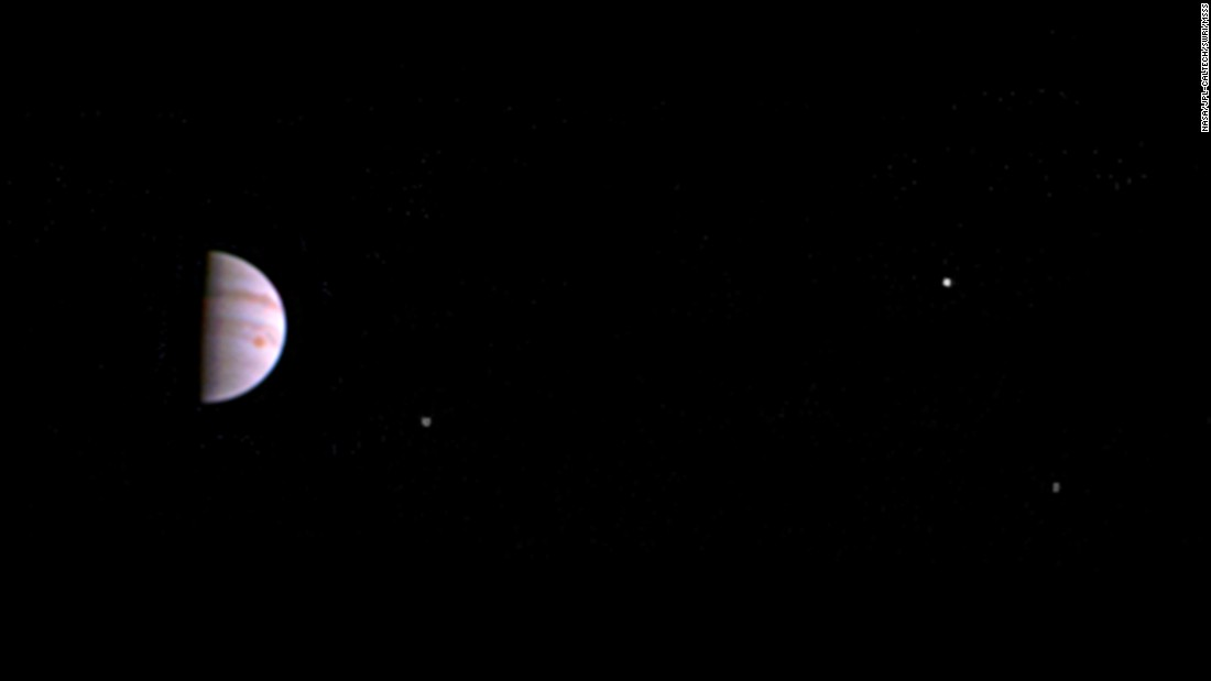 NASA's Juno spacecraft has sent back its first photo of Jupiter, left, since entering into orbit around the planet. The photo, obtained July 10, is made from some of the first images taken by JunoCam and shows three of the massive planet's four largest moons -- Io, Europa and Ganymede, from left to right in the image.