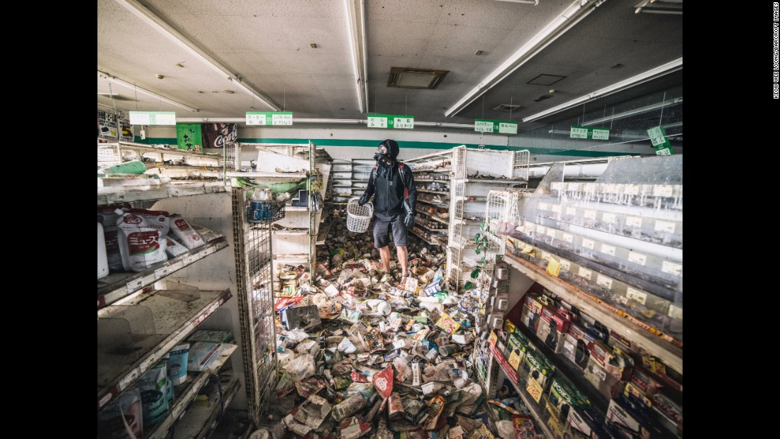 Last month, Malaysian photographer Keow Wee Loong and two colleagues managed to get past authorities and make their way into Fukushima's exclusion zone. The area remains mostly untouched since a 9.0 magnitude earthquake, the worst to ever hit Japan, followed by a tsunami, devastated the country on March 11, 2011. In this photo, Loong is seen at a supermarket full of old merchandise.