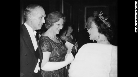 The Queen meets former Prime Minister Sir Alec Douglas-Home and Lady Home at County Hall in London, November, 11 1964.