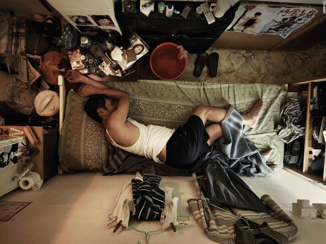 "Hong Kong photographer Benny Lam created this series to illustrate the cramped quarters -- sometimes called ""shoebox homes"" -- for the city's poorest residents. ""In the photos you can see the physical space,"" says Lam, ""but if you could experience the smell and the temperature, you would feel like it was hell."""