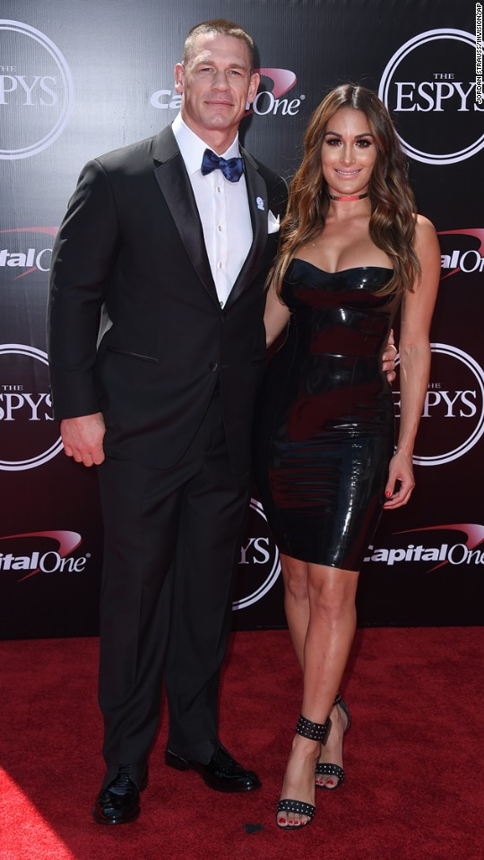 Host John Cena, left, and his girlfriend, professional wrestler Nikki Bella, arrive at the ESPY Awards on Wednesday, July 13, in Los Angeles.