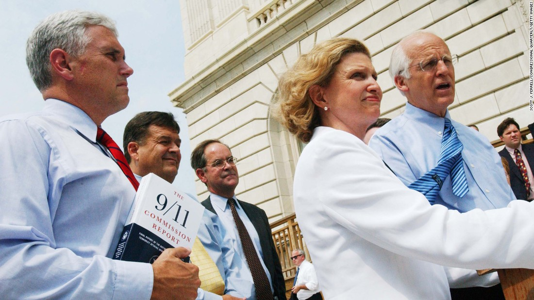 Pence, Reps. Carolyn B. Maloney, D-New York, and Christopher Shays, R-Connecticut, walk with a bipartisan group of members during a news conference on July 22, 2004, about the release of the 9/11 Commission report.