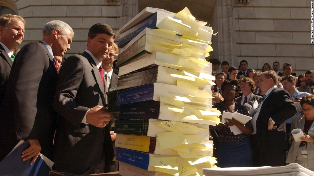 From left, Reps. Ted Poe (R-Texas), Pence, Jeb Hensarling (R-Texas) and Flake attend a news conference on September 21, 2005, to call for budget offsets to pay for the Hurricane Katrina relief and reconstruction effort. Copies of the budget were displayed with sections earmarked. Members of FreedomWorks, a conservative and libertarian advocacy group, were also on hand to call on cuts for wasteful pork-barrel projects, along with many members of the House Republican Study Committee.