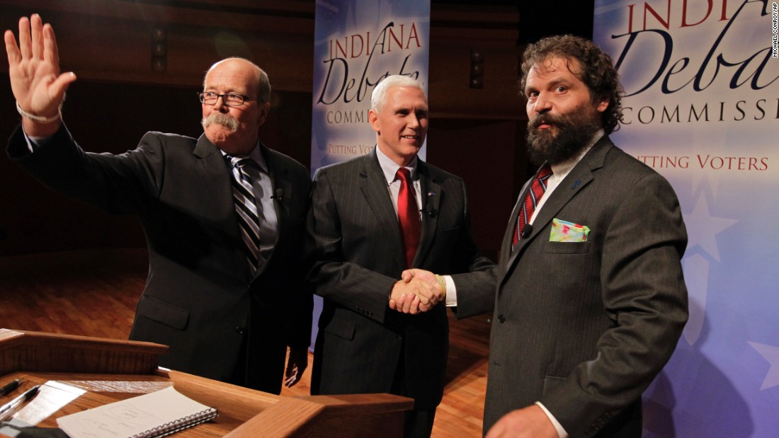 The three candidates for Indiana governor, Democrat John Gregg, left, Pence and Libertarian Rupert Boneham, gather after a debate in South Bend, Indiana, on October 17, 2012.