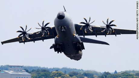 he Airbus A400M takes part in a flying display at the Farnborough Airshow, south west of London, on July 12, 2016. / AFP / ADRIAN DENNIS (Photo credit should read ADRIAN DENNIS/AFP/Getty Images)