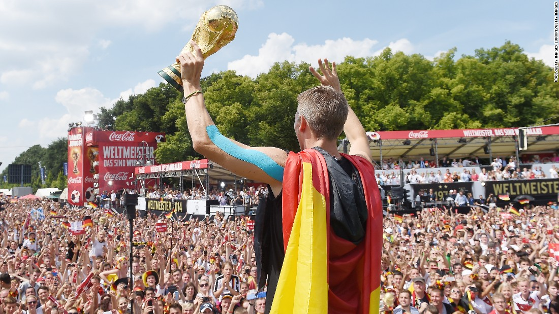 Schweinsteiger showed off the World Cup trophy in Berlin as Germany celebrated winning 2014 tournament in Brazil.