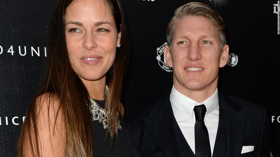 "Schweinsteiger and Ivanovic pose for pictures on the red carpet as they arrive to attend the ""United for UNICEF Gala Dinner"" at Old Trafford in Manchester on November 29, 2015."