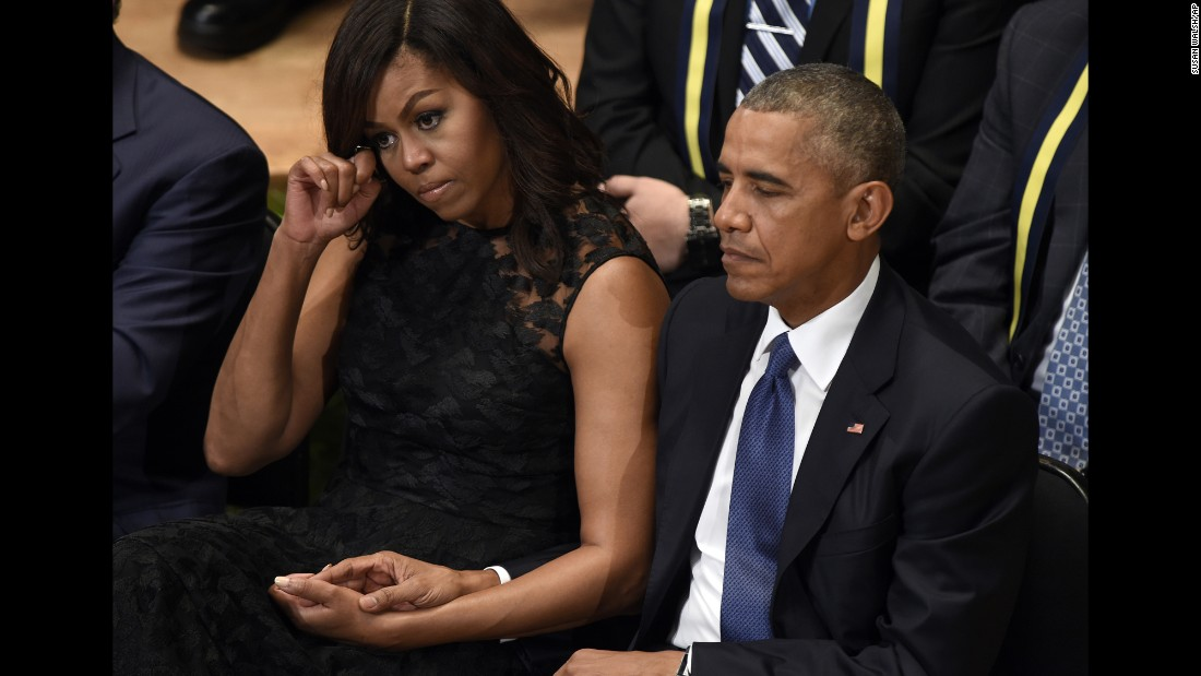 "U.S. President Barack Obama and first lady Michelle Obama attend an interfaith memorial service in Dallas on Tuesday, July 12, after the <a href=""http://www.cnn.com/2016/07/08/us/philando-castile-alton-sterling-protests/index.html"" target=""_blank"">killing of five police officers</a> during an anti-police brutality protest in the city just days before."