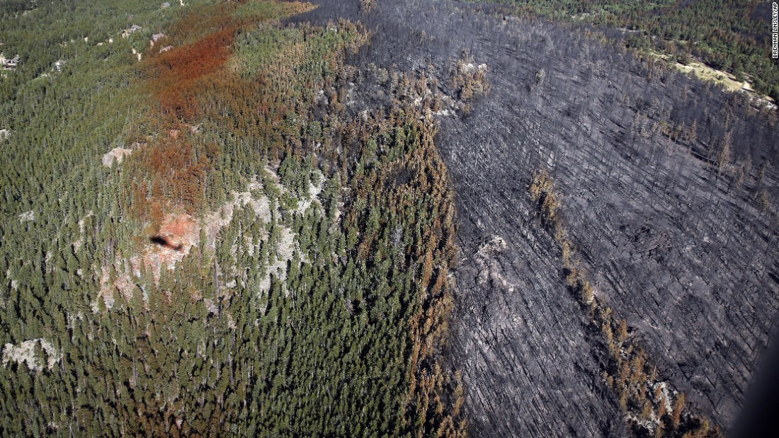 Fire damage is seen from a Colorado National Guard Blackhawk helicopter after four days battling a blaze outside Nederland on Tuesday, July 12. As of Wednesday, the fire had destroyed eight homes since breaking out the previous Saturday and was 25% contained.