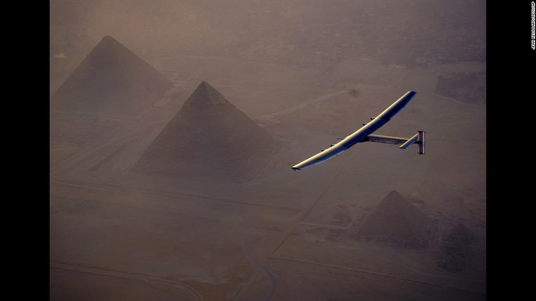 Solar Impulse 2 flies over pyramids in Cairo on Wednesday, July 13. The experimental solar-powered airplane arrived in Egypt as part of its global voyage.