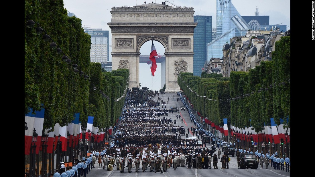 "Troops wait near the Arc de Triomphe in Paris before taking part in the annual <a href=""http://www.cnn.com/videos/world/2016/07/14/france-bastille-day-anderson-cnni-nr-lklv.cnn/video/playlists/top-news-videos/"" target=""_blank"">Bastille Day parade</a> on the Champs-Elysees on Thursday, July 14. About 3,000 soldiers marched at the event, which marks the beginning of the French Revolution in 1979."