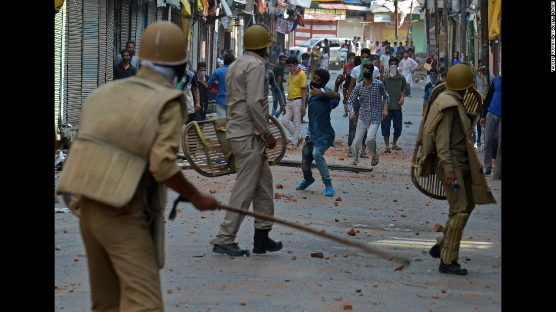 Indian police clash with Kashmiri protesters in Srinagar on Monday, July 11.