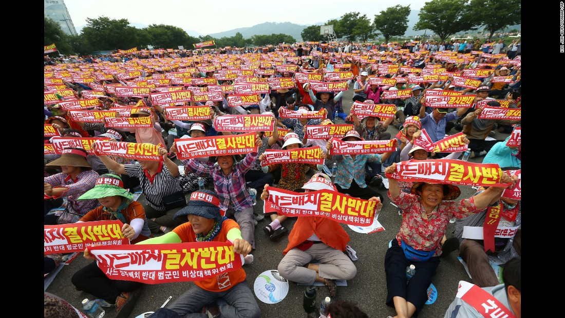"People hold up banners during a rally to oppose deploying the Terminal High-Altitude Area Defense, or THAAD, in Seongju, South Korea, on Wednesday, July 13. <a href=""http://www.cnn.com/2016/07/13/asia/what-is-thaad/"" target=""_blank"">An advanced U.S. missile defense system will be deployed</a> in a rural farming town in southeastern South Korea, Seoul officials announced Wednesday, angering not only North Korea and China but also local residents who fear potential health hazards they believe the U.S. system might cause. The banners state, ""Oppose deploying the THAAD."""