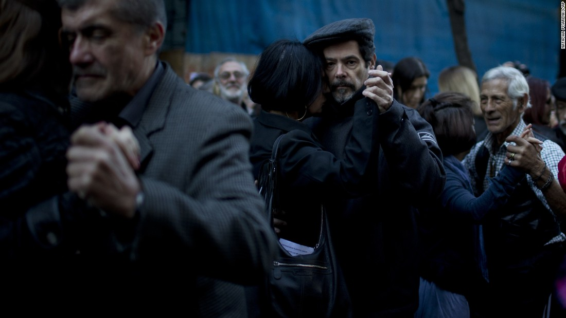 Couples tango in the street in Buenos Aires on Tuesday, July 12. Tango and milonga dance room owners protested the rise of up to 400% in gas and electricity bills, arguing they might have to close their businesses because of the increases.