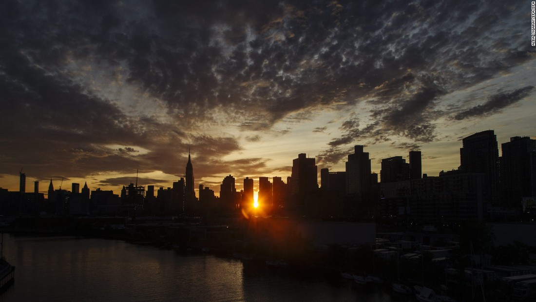 "The sun sets behind the New York skyline during Manhattanhenge, a twice-a-year occurrence in which the setting sun aligns with the street grid of the city, on Monday, July 11. <a href=""http://www.cnn.com/2016/07/08/world/gallery/week-in-photos-0708/index.html"" target=""_blank"">See last week in 31 photos</a>"