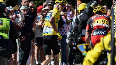 Chris Froome is forced to run up part of Mont Ventoux on Bastille Day.