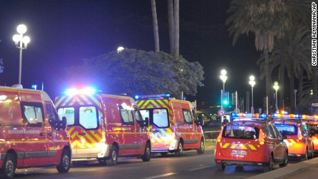 "Fire department ambulances and vehicles are parked near the scene of an attack after a truck drove on to the sidewalk and plowed through a crowd of revelers who'd gathered to watch the fireworks in the French resort city of Nice, southern France, Friday, July 15, 2016. A spokesman for France's Interior Ministry says there are likely to be ""several dozen dead"" after a truck drove into a crowd of revelers celebrating Bastille Day in the French city of Nice. (AP Photo/Christian Alminana)"