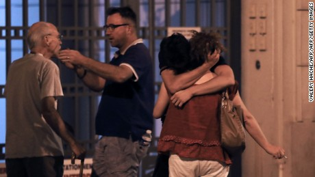 EDITORS NOTE: Graphic content / People react in the French Riviera town of Nice on July 15, 2016, after a van drove into a crowd watching a fireworks display. At least 60 people were killed when a truck ploughed into a crowd watching a Bastille Day fireworks display in the southern French resort of Nice, prosecutors said early on July 15. Nice prosecutor Jean-Michel Pretre said the truck drove two kilometres (1.3 miles) through a large crowd that was watching the fireworks.  / AFP / Valery HACHE        (Photo credit should read VALERY HACHE/AFP/Getty Images)