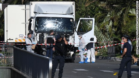 "Forensics officers and policemen look for evidences in a truck on the Promenade des Anglais seafront in the French Riviera town of Nice on July 15, 2016, after it drove into a crowd watching a fireworks display. An attack in Nice where a man rammed a truck into a crowd of people left 84 dead and another 18 in a ""critical condition"", interior ministry spokesman Pierre-Henry Brandet said Friday. An unidentified gunman barrelled the truck two kilometres (1.3 miles) through a crowd that had been enjoying a fireworks display for France's national day before being shot dead by police.  / AFP / ANNE-CHRISTINE POUJOULAT        (Photo credit should read ANNE-CHRISTINE POUJOULAT/AFP/Getty Images)"