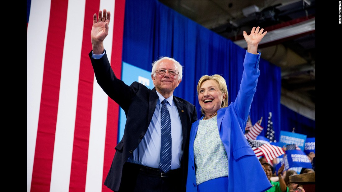 "Vermont Sen. Bernie Sanders and Democratic presidential candidate Hillary Clinton wave to supporters during a rally in Portsmouth, New Hampshire, on Tuesday, July 12. <a href=""http://www.cnn.com/2016/07/11/politics/hillary-clinton-bernie-sanders/"" target=""_blank"">Sanders officially endorsed Clinton</a>, saying, ""I intend to do everything I can to make certain she will be the next president of the United States."""