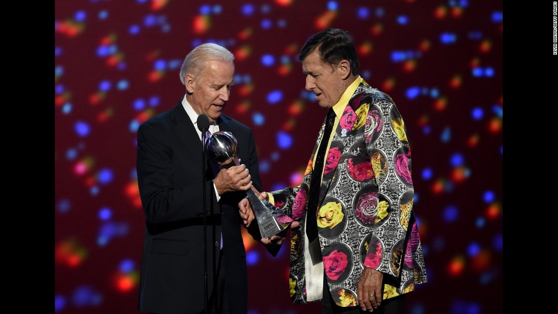 U.S Vice President Joe Biden, left, presents the Jimmy V Award for Perseverance to honoree Craig Sager  during the 2016 ESPYS at the Microsoft Theater in Los Angeles on Wednesday, July 13.