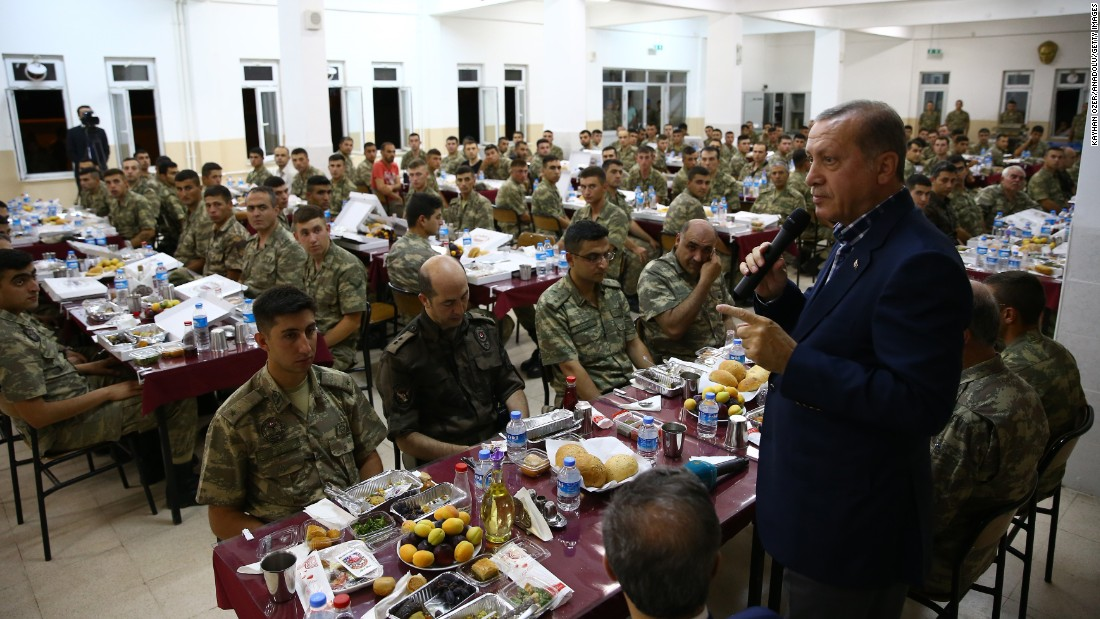 Erdogan, right, attends an Iftar dinner during his visit to the Tank Battalion campus in the Cizre district of Sirnak, Turkey, on Saturday, June 25.