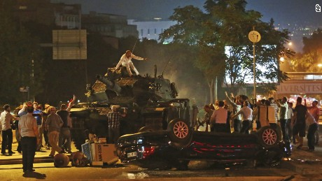 "Tanks move into position as Turkish people attempt to stop them, in Ankara, Turkey, early Saturday, July 16, 2016. Turkey's armed forces said it ""fully seized control"" of the country Friday and its president responded by calling on Turks to take to the streets in a show of support for the government. A loud explosion was heard in the capital, Ankara, fighter jets buzzed overhead, gunfire erupted outside military headquarters and vehicles blocked two major bridges in Istanbul."