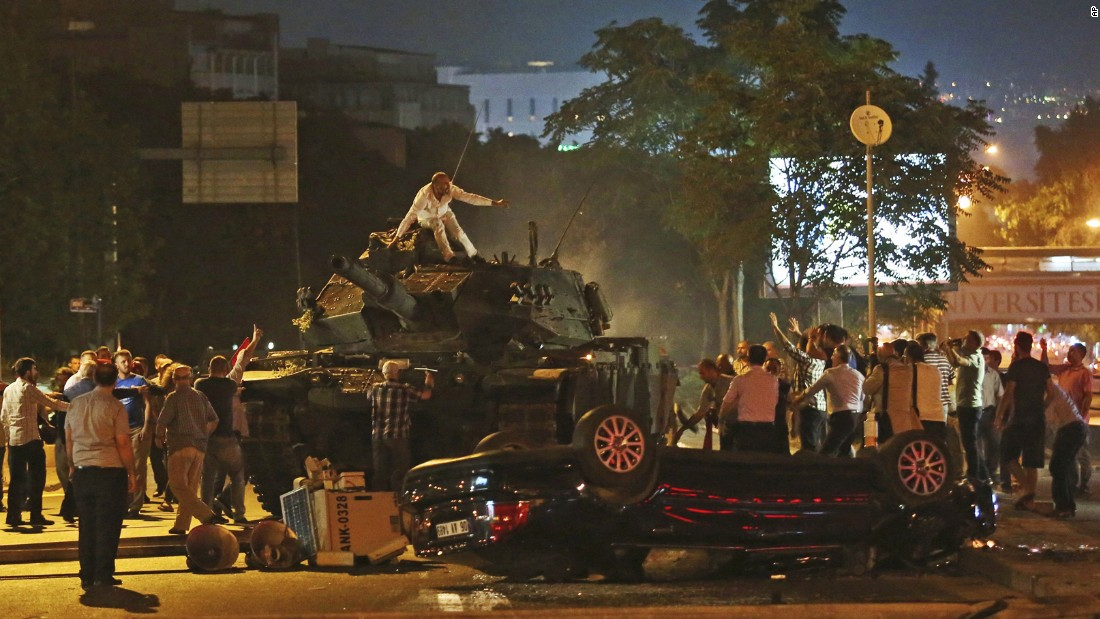 Tanks move into position as Turkish citizens attempt to stop them in Ankara.