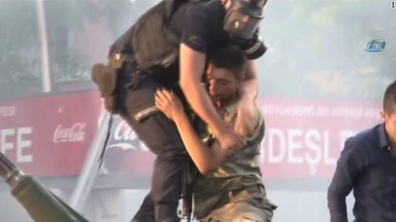 Turkey coup: Soldier pulled to safety by police