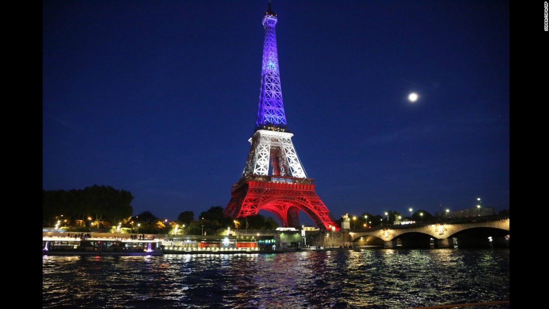 The Effiel Tower is illuminates in the colors of French national flag to pay tribute to the victims of the Nice terrorist attack France on July 15