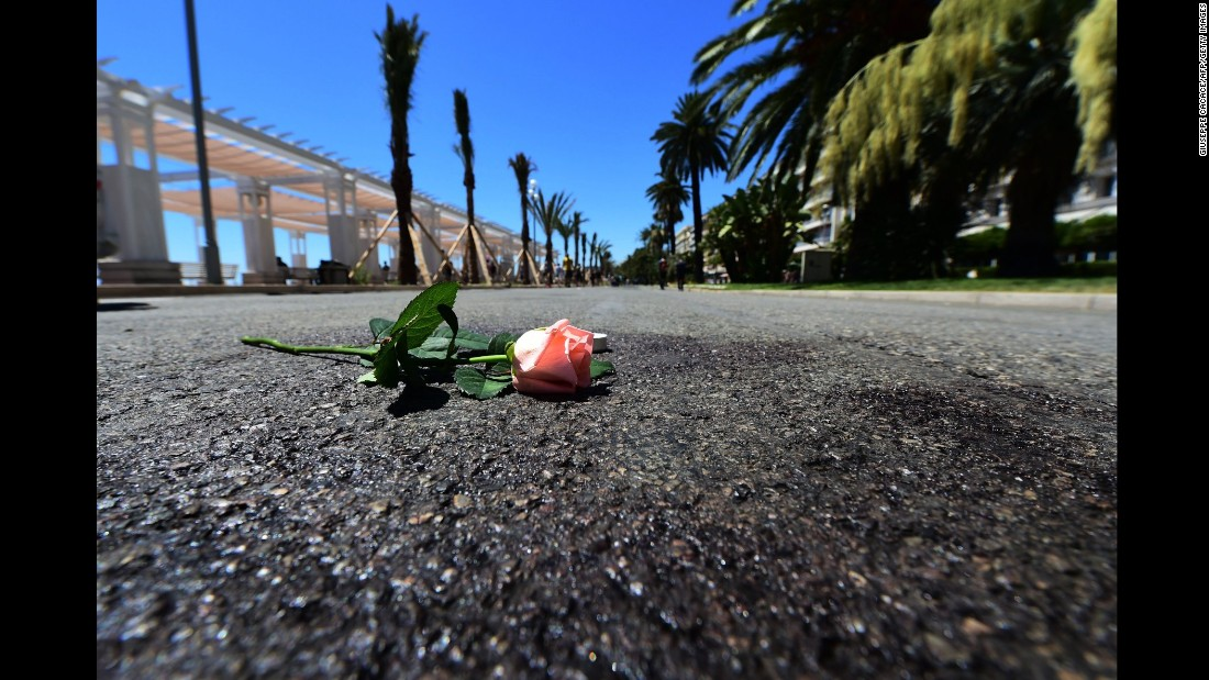 A flower was laid on a blood mark of one of the victims of the deadly Bastille Day attack in the Promenade des Anglais in Nice.
