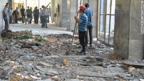 Workers clean up debris at Turkish parliament in Ankara.