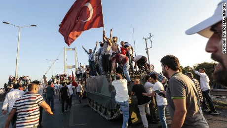 The Turkish President's supporters celebrate after soldiers surrendered on Istanbul's Bosphorus Bridge.