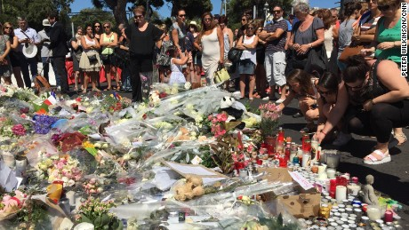 Numerous flowers, candles and other tributes lie in Nice, France, on Saturday in memory of those killed in Thursday's terror attack in the coastal city.