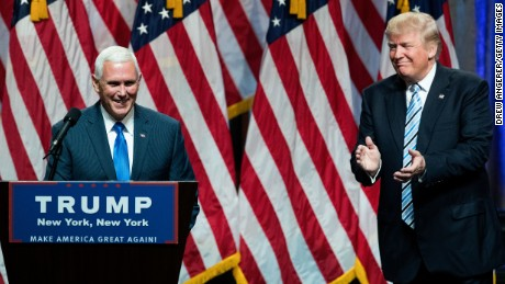 Republican presidential candidate Donald Trump (R) introduces his newly selected vice presidential running mate Mike Pence (L), governor of Indiana, during an event at the Hilton Midtown Hotel, July 16, 2016 in New York City.