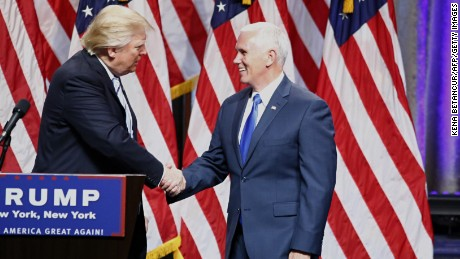 US Republican presidential nominee Donald Trump (L) shakes hand with his vice presidential running mate Indiana Governor Mike Pence on July 16, 2016, during a press conference in New York.