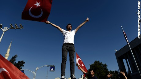 A man waves a Turkish flag during a demonstration in Istanbul in support the government on July 16 following a failed coup attempt.