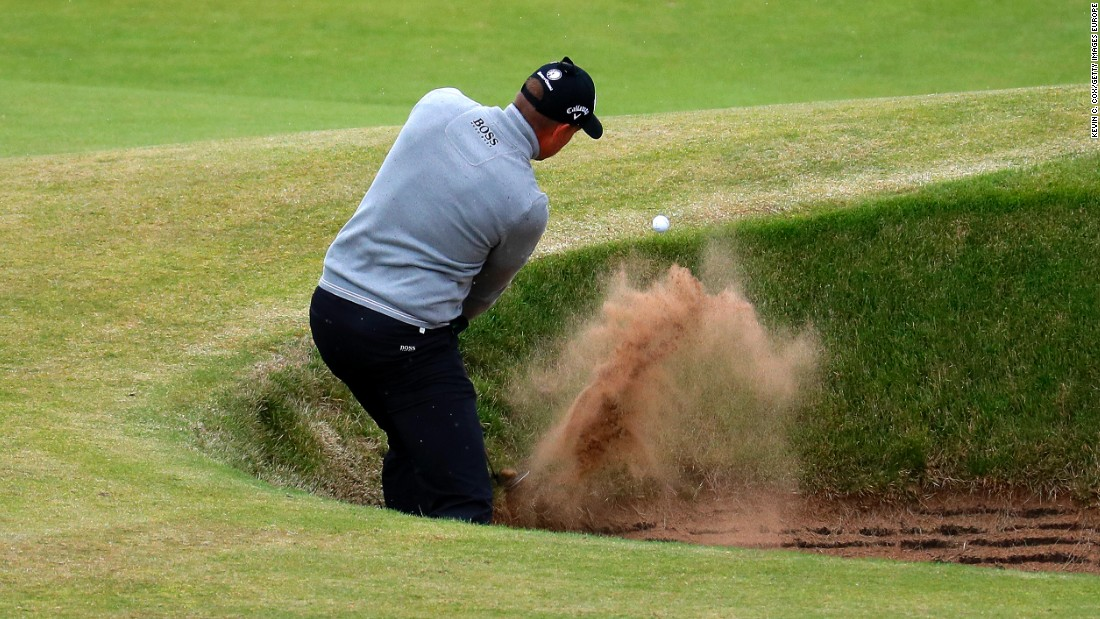 Stenson has to play out of one of the many steep bunkers at Troon on the 7th hole during his third round 68.
