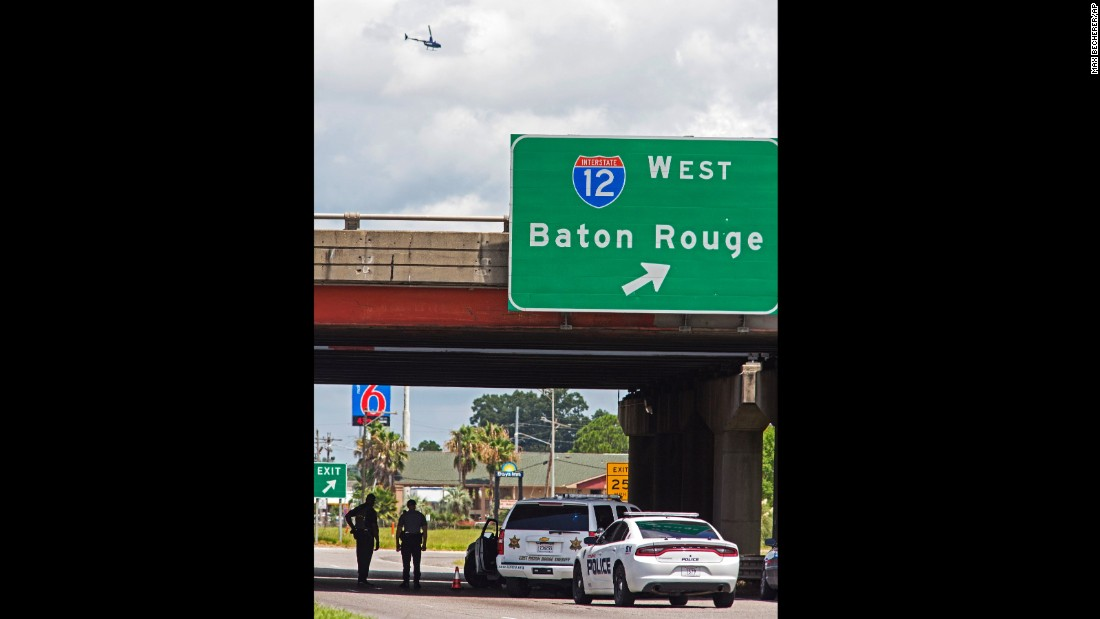 Baton Rouge police block Airline Highway after police officers were shot on Sunday, July 17.