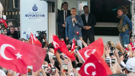 "Turkish President Recep Tayyip Erdodan (C) speaks during a rally near his house in Istanbul on July 16, 2016 after Turkish authorities wrested back control of the Ataturk airport.  President Recep Tayyip Erdogan urged Turks to remain on the streets on July 16, 2016, as his forces regained control after a spectacular coup bid by discontented soldiers that claimed more than 250 lives. Describing the attempted coup as a ""black stain"" on Turkey's democracy, Yildirim said that 161 people had been killed in the night of violence and 1,440 wounded. / AFP / GURCAN OZTURK        (Photo credit should read GURCAN OZTURK/AFP/Getty Images)"