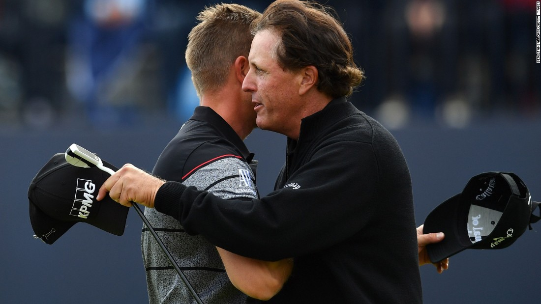 Stenson and Mickelson embrace after their incredible final round showing with the Swede equaling the major championship record round with an eight-under 63. Mickelson shot a 65.