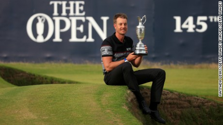 TROON, SCOTLAND - JULY 17:  Henrik Stenson of Sweden celebrates victory as he poses with the Claret Jug on the the 18th green after the final round on day four of the 145th Open Championship at Royal Troon on July 17, 2016 in Troon, Scotland. Henrik Stenson of Sweden finished 20 under for the tournament to claim the Open Championship.  (Photo by Matthew Lewis/Getty Images)