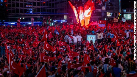ANKARA, TURKEY - JULY 17:  People wave Turkish flags at a rally on the streets of Kizilay Square in reaction to the failed military coup on July 17, 2016 in Ankara, Turkey. Clean up operations are continuing in the aftermath of Friday's failed military coup attempt which claimed the lives of more than 250 people. In raids across Turkey 6,000 people have been arrested in relation to the failed coup including high-ranking soldiers and judges, Turkey's Justice Minister Bekir Bozdag has said.  (Photo by Chris McGrath/Getty Images)