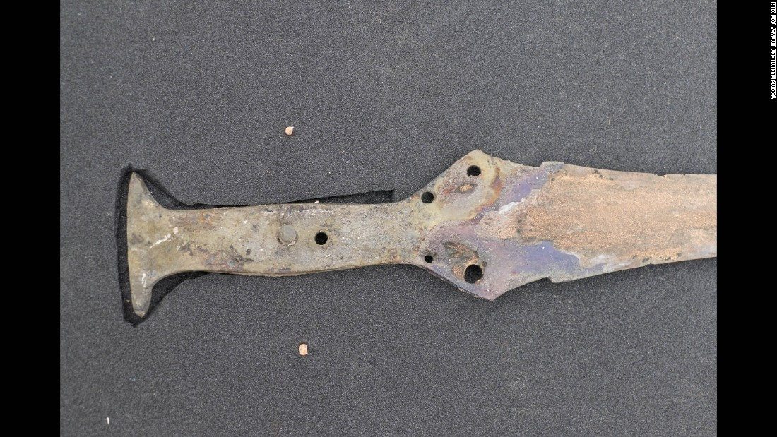 A Wilburton-type sword is seen with rivets and fragments of lead pommel.