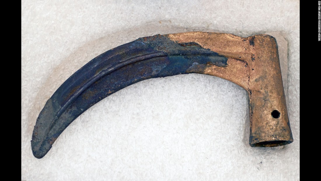A preserved Bronze-age sickle placed in protective material.