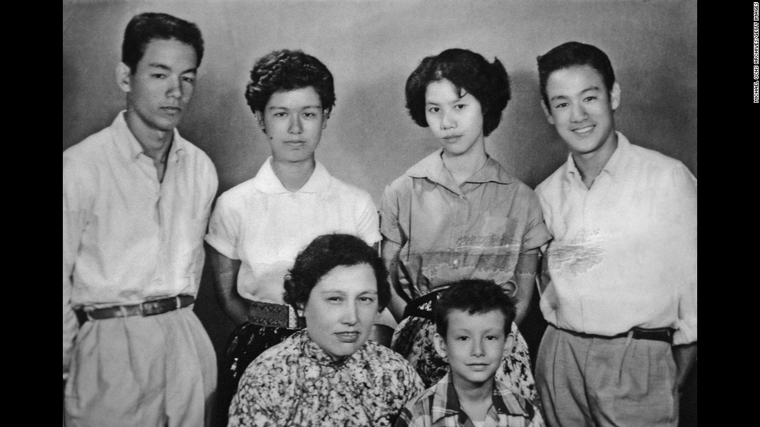 Bruce Lee, right,                                                                                                                                                                                                                                                                                                                                                                                                                                                                                                                                                                                                                                                                                                                                                                                                                                                                                                                                                                                        along with his mother and siblings poses for a family snapshot circa the late 1950s in Kowloon, Hong Kong. Lee grew up in an affluent family. His father was a famous opera star.