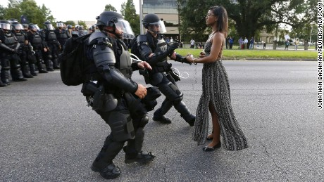"Protestor Ieshia Evans is detained by law enforcement near the headquarters of the Baton Rouge Police Department in Baton Rouge, Louisiana, U.S. July 9, 2016.  REUTERS/Jonathan Bachman     TPX IMAGES OF THE DAY      SEARCH ""#BLACK LIVES MATTER"" FOR THIS STORY. SEARCH ""THE WIDER IMAGE"" FOR ALL STORIES. (Newscom TagID: rtrleight015657.jpg) [Photo via Newscom]"
