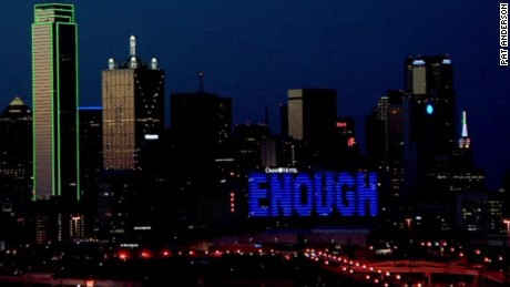 "A Dallas hotel displays the words ""Enough"" after the police attack."